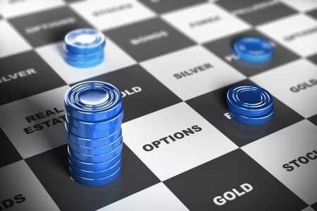 diversify: Blue checkers pieces over a financial board where it is written some investment words  Financial concept  Stock Photo