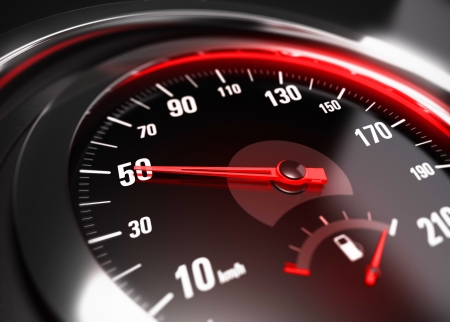 speed limit: Close up of a car speedometer with the needle pointing 50 Km h, blur effect, conceptual image for safe driving concept
