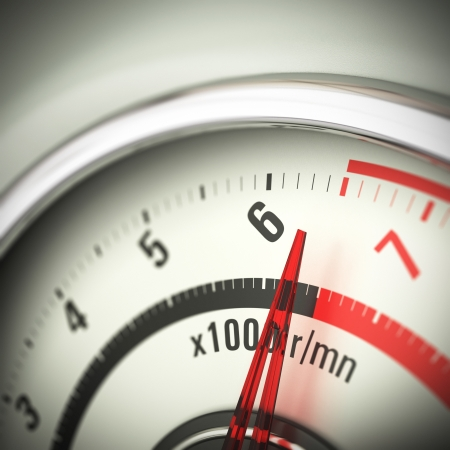 rev: Close up of a tachometer with blur effect and the needle pointing just below the red limit
