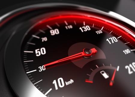 compteur de vitesse: Près d'un compteur de vitesse de la voiture avec l'aiguille pointée vers 30 km h, effet de flou, image conceptuelle pour le concept de la sécurité routière Banque d'images
