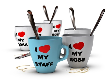 Many mugs where it is written I love my staff and my boss, symbol of staff relations and motivation in workplace  Stock Photo