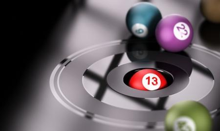 Concepto de juego, el azar y el número trece Una bola con la imagen de render 3D Conceptual número 13 en el interior de un agujero con otras bolas alrededor