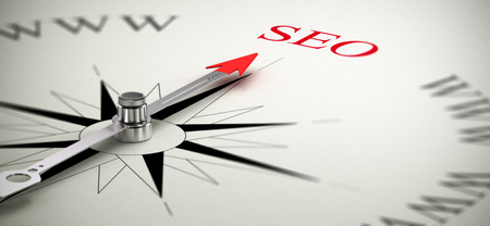webmarketing: Compass with the needle pointing the word SEO, Search Engine Optimization concept image  Stock Photo