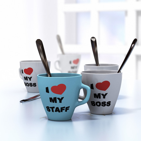 Conceptual 3D render image with depth of field blur effect  Many mugs where it is written I love my staff and my boss, symbol of wellbeign at work and good workplace relationship  Stock Photo