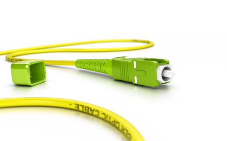 connexion: Close up of a fiber optic patchcord over white background with blur effect