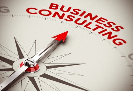 Realistic concept of strategic business  Compass needle pointing the red word business consulting over a paper background photo