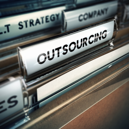 out of production: Folder tab with focus on the the word outsourcing  Contracting out or subcontracting concept image with blur effect  Stock Photo