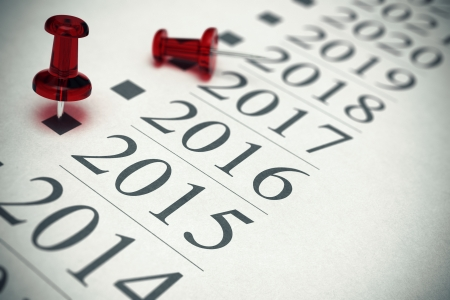 fifteen: Year 2015 written on a paper with a red pushpin, concept image for business vision or objectives in two thousand fifteen.