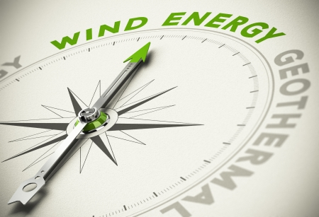 energy savings: Compass with needle pointing the text WIND ENERGY - Green and renewable energies concept blur effect with focus on the main word. Stock Photo