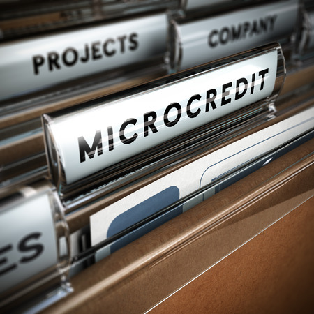 Folder with focus on a tab and the word microcredit, blur effect  Concept of company projects funding Imagens - 26018743