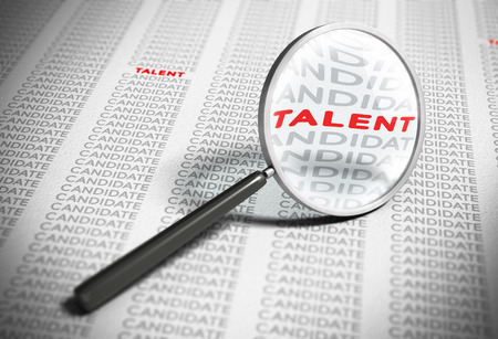 talent management: Magnifier with focus on the word talent with many words candidates around it. Blur effect concept of recruitment. Stock Photo