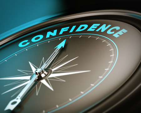 self confident: Compass with needle pointing the word confidence, self esteem concept with blue and brown tones  Focus on the top