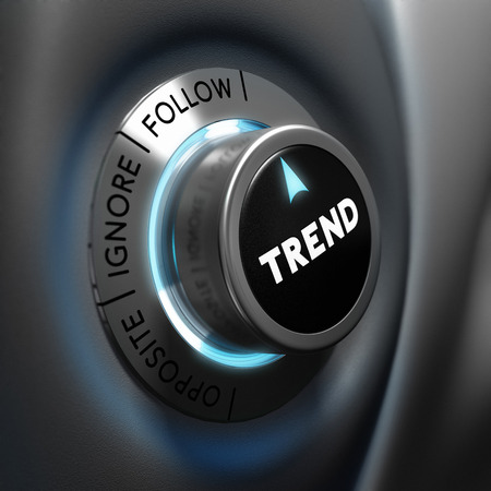 Concetto Trading, pulsante tendenza puntando la parola segue grigio scuro e su sfondo blu, messa a fuoco e sfocatura effetto