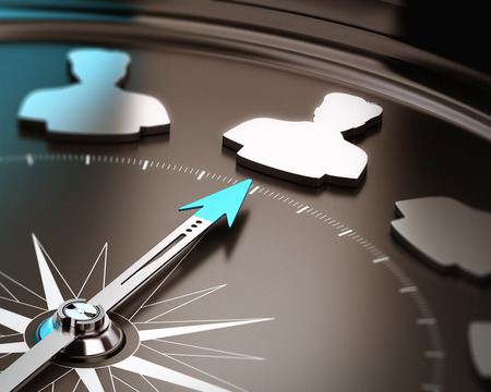 focus on: Recruitment or hiring qualified candidate concept  Compass needle pointing a talent symbol over a brown and blue background with focus and blur effect