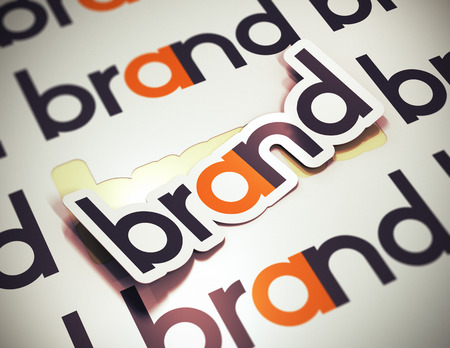 branding: Sticker with the word brand over a beige background  Brand name concept  The image is a 3D rendering with blur effect