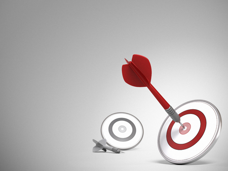 targets: Two targets and one dart hitting the center of the red one, room for text on the left and top of the image  Illustration for a success concept or achieving performance