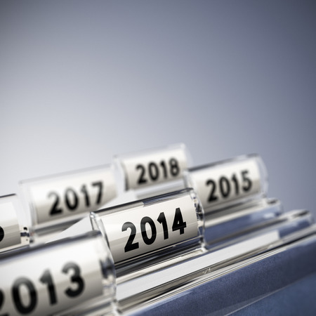 Folder tab with focus on 2014, blue background  Taxes concept for illustration of mid-term or long-term business strategy