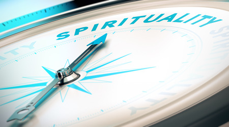 consultancy: Compass with needle pointing the word spirituality  Conceptual 3D render image with depth of field blur effect for illustration of search of spiritual life