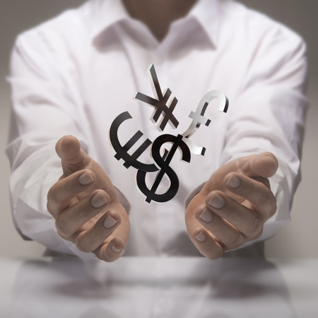 foreign currency: Man hands holding currencies symbols. currency exchange service concept.