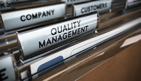 quality assurance: Folder tabs with focus and blur effect. Business concept image for illustration of quality management system.