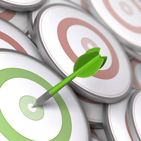 strategy decisions: One dart hitting the center of a modern dartboard, targets concept to illustrate Business options or Marketing strategies. Stock Photo