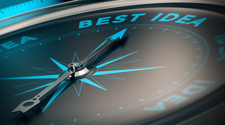 Compass with needle pointing the words best idea, concept image to illustrate vision and business strategy.