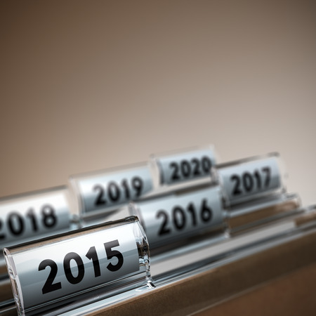 longterm: File tab with focus on 2015 year, beige background. Image concept for illustration of mid-term or long-term business strategy. Stock Photo
