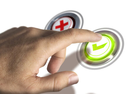 quality questions: One finger pressing a green validation button, image concept of approval.
