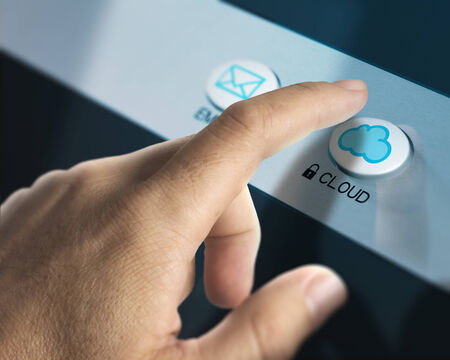 One finger pressing a cloud button, image concept of cloud computing. photo