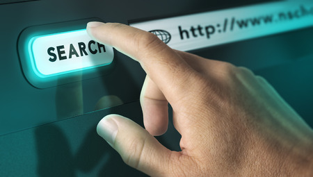 webmarketing: One finger pressing a search engine button, image concept of internet search and interactive terminal. Stock Photo