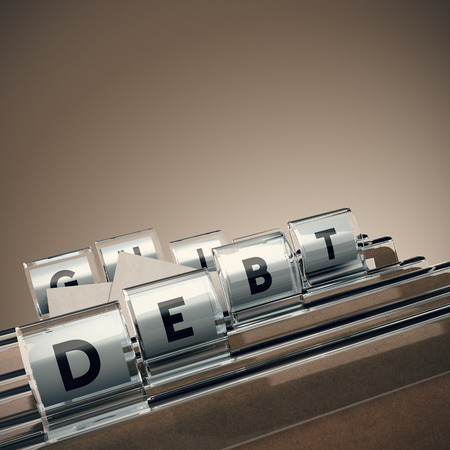 debt management: folder with the word debt with blur effect and perspective
