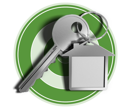 keyring: Real estate concept key and house shaped keyring over green target and white background. Stock Photo