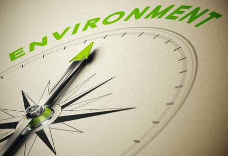 Compass with needle pointing the word environment, green and beige tones. Background image for illustration of environmental concept. illustration