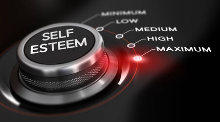 self improvement: Switch button positioned on the word maximum, black background and red light. Conceptual image for illustration of self esteem.
