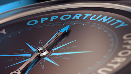 Compass with needle pointing the word opportunity, concept image to illustrate business opportunities and strategy.