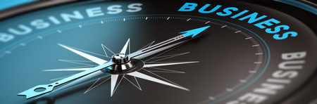 Conceptual compass with needle pointing the word business, black and blue tones. Concept background image for illustration of business consulting.