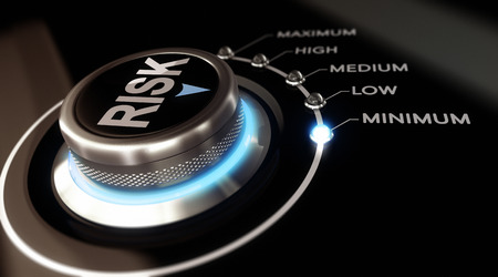 Switch button positioned on the word minimum, black background and blue light. Conceptual image for illustration of Risk management or assessment. 写真素材
