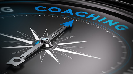 Conceptual Compass with needle pointing to the word coaching. Banque d'images
