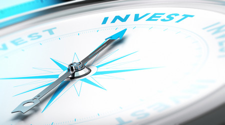 strategist: Conceptual Compass with needle pointing to the word invest Stock Photo