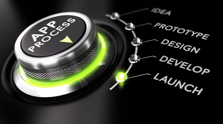 Switch button with green light, black background. Conceptual image for illustration of app development process.