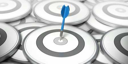 One dart in the center of one target. Many other targets around it. Concept image for illustration of Maketing stratgy or best choice.