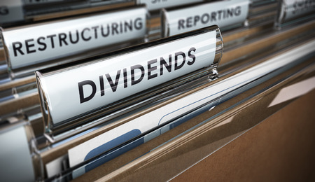 dividends: File tab with focus on the word dividends. Conceptual image for illustration of company restructuring plan and dividend.