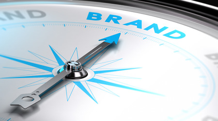 Choosing a brand name concept. 3D image with a compass with needle pointing the word brand. Blue and white tones. Standard-Bild