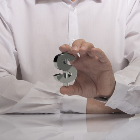 hand holding dollar sign, white shirt and reflexion. symbol of profit and making money