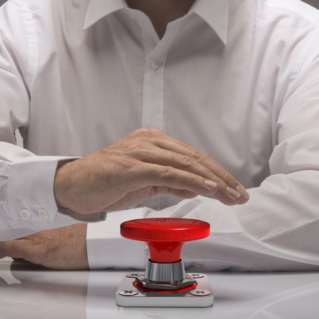 push: hand pushing emergency button, white shirt and reflexion. symbol of urgency and problem solving Stock Photo
