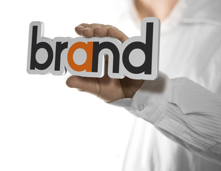 Caucasian man holding a brand name, copy space on the left side of the image. Identity concept over white background. Stock Photo