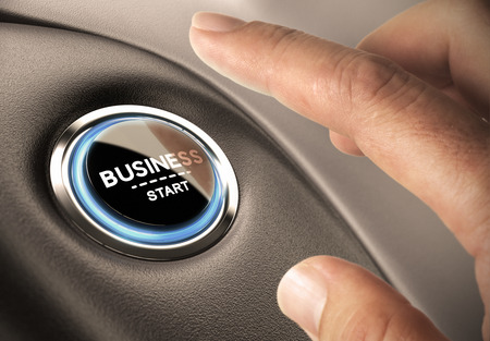 business analysis: Finger pressing business button. Blue and black tones. Start up concept.