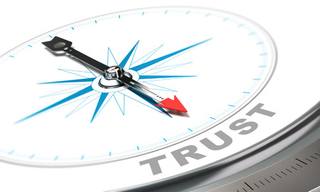 trust: Compass with needle pointing the word trust, confidence concept over white background. Stock Photo