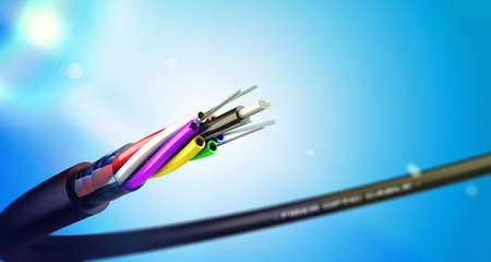Stripped fiber optic cable over blue background with spot lights, communication network technology. Banco de Imagens