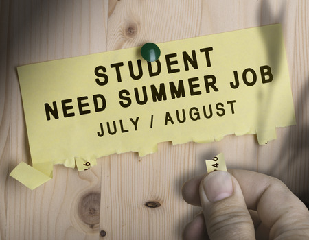 seasonal worker: Tear off not with the text student need summer job over wooden background